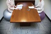 Businesswomen sitting on exercise balls in meeting — Stock Photo