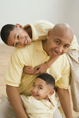 Indian father and sons hugging — Stock Photo