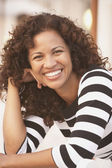 Hispanic woman smiling — Stock Photo