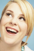 Close up of young woman looking up — Stock Photo
