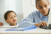 African boy watching brother study — Foto Stock
