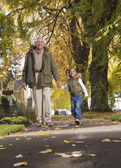 African grandfather and granddaughter taking a walk — Stock Photo