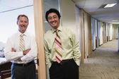 Portrait of two businessmen in doorway of office — Stock Photo