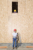 Portrait of male and female construction workers — Stock Photo