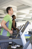 Two men exercising at health club — Stock Photo