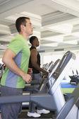 Two men exercising at health club — Stock Photo
