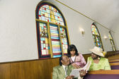 African American reading in church — Stock Photo