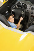 Hispanic boy sitting in new car — Stock Photo