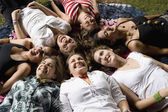 Group of Hispanic women laying on grass — Stock Photo