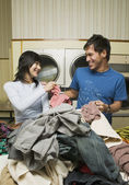 Asian couple in Laundromat — Stock Photo