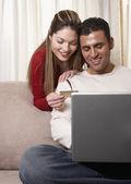 Hispanic couple shopping online — Stock Photo