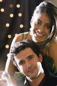 Portrait of Hispanic couple hugging — Stock Photo
