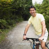 Man riding bicycle on nature trail — Stock Photo