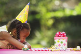 African girl looking at birthday gift — Stock Photo