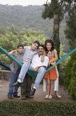 Hispanic family hugging outdoors — Stock Photo