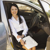 Eurasian businesswoman sitting in car — Stock Photo