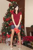 Hispanic woman holding Christmas gift — Stock Photo