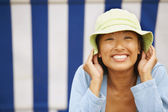 Asian woman wearing sun hat — Stock Photo