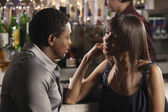 African couple talking at bar — Foto Stock