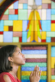 African American woman praying in church — Stock Photo