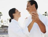 Hispanic couple dancing at beach — Photo