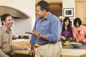 Two middle-aged men talking in kitchen — Stock Photo