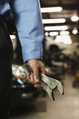 Male auto mechanic holding vice grips — Stock Photo