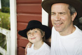Father and son wearing cowboy hats — Stock Photo