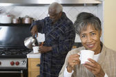 Senior African couple drinking coffee — Stock Photo