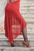 Hispanic woman in tango dress on steps — Stock Photo
