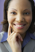 Close up of African businesswoman smiling — Stock Photo