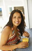 Hispanic woman drinking at bar — Stock Photo