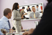 Multi-ethnic businesspeople having video conference — Stock Photo