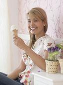 Hispanic woman eating ice cream cone — Stock Photo