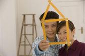 Cetvel gibi ev şeklinde katlanır asya çift — Stok fotoğraf