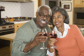 Senior African couple toasting with wine — Fotografia Stock