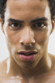 Close up of Mixed Race man's wet face — Stock Photo