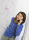 Asian girl talking on cell phone — Stock Photo