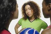 Multi-ethnic women holding soccer ball — Stock Photo