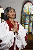 African American female Reverend praying — Foto de Stock