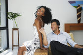 South American couple sitting on chair — Stok fotoğraf