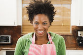 African American woman wearing apron — Stock Photo