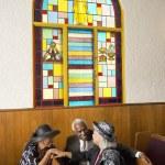 African senior talking in church — Stock Photo #23306582