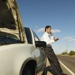 Hispanic man broken down on side of road — Stock Photo #23307836
