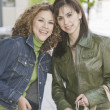 Two Hispanic women holding shopping bags — Stock Photo
