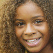 Close up of AfricAmericgirl smiling — Stock Photo #23306144