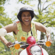 Senior African American woman riding motor scooter — Stock Photo #23306148