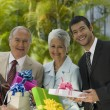 Hispanic businesspeople holding gifts — Stock Photo