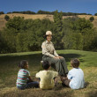 Multi-ethnic children listening to Park Ranger — Stock Photo