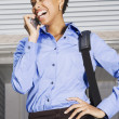 African American businesswoman talking on cell phone — Stock Photo #23306302